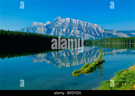 Mountain reflection in Two Jack Lake and Mount Rundle, Banff National Park, Alberta, Canada - Stock Photo