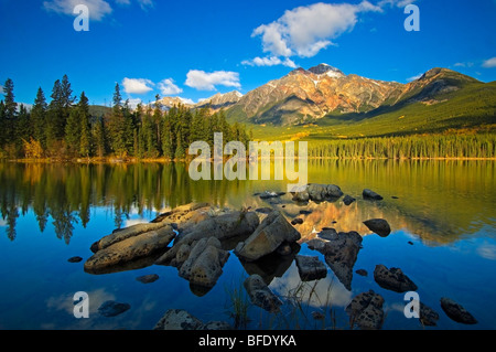 Pyramid Mountain reflected in Pyramid Lake in Jasper National Park, Alberta, Canada - Stock Photo