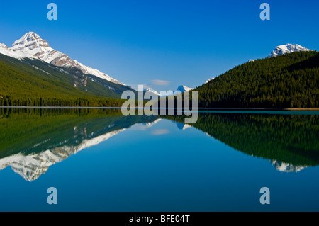 Mount Weed, at left, reflected in Lower Waterfowl Lake, Icefields Parkway, Banff National Park, Alberta, Canada - Stock Photo