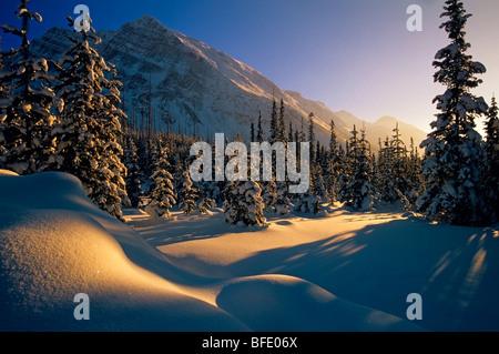 Sunset over winter landscape, at Boom Lake, Banff National Park, Alberta, Canada - Stock Photo