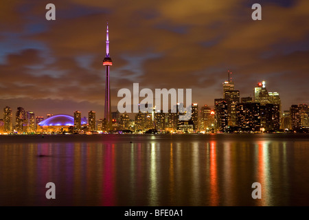 Toronto skyline at night from Toronto Islands, Ontario, Canada - Stock Photo
