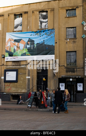 Young people outside of Old Truman Brewery in Brick Lane, East End East London England UK - Stock Photo