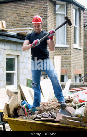 Builder with sledge hammer - Stock Photo