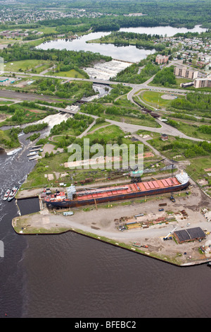 Large freighter in dry dock along the waterfront in the city of Thunder Bay, Ontario, Canada - Stock Photo