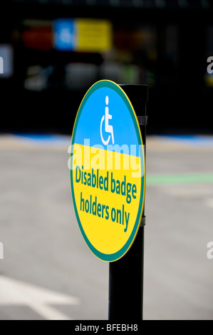 Disabled badge holders only  - signage outside Morrisons store in East Sussex. UK. - Stock Photo