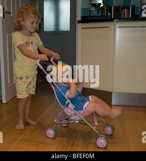 little brother in pushchair - Stock Photo