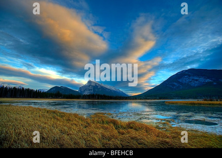 Sunset clouds over Mount Rundle and the Vermillion Lakes, Banff, Alberta, Canada - Stock Photo