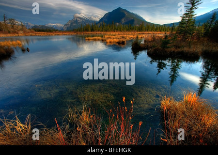 Mount Rundle reflected in the Vermillion Lakes outside of Banff, Alberta, Canada - Stock Photo