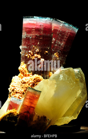 Red and green tourmaline with quartz crystals. - Stock Photo