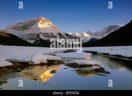 Sunwapta River with Sunwapta Peak and Mount Kitchener in winter, Jasper National Park, Alberta, Canada - Stock Photo