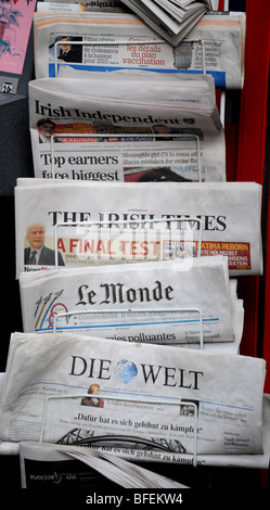 International newspapers for sale on a news stand in Brighton Sussex UK - Stock Photo
