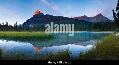 Sunrise over Mount Chephren & Epaulette Mountain from Mistaya River, Banff National Park, Alberta, Canada - Stock Photo
