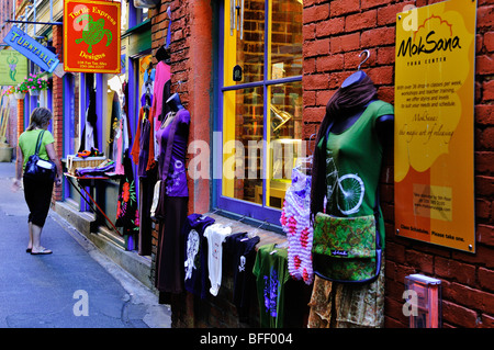 Woman (model release) shopping in Fan Tan Alley in Chinatown in Victoria, BC. - Stock Photo