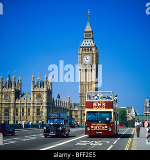 Sightseeing double decker bus and taxi on Westminster bridge and Westminster Palace with Big Ben London Great Britain - Stock Photo