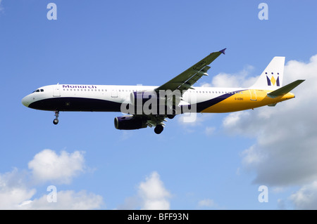 Airbus A321 operated by Monarch Airlines on approach for landing at Birmingham Airport - Stock Photo