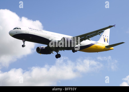 Airbus A3231 operated by Monarch Airlines on approach for landing at Birmingham Airport - Stock Photo