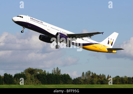 Airbus A3231 operated by Monarch Airlines taking off from Birmingham Airport - Stock Photo