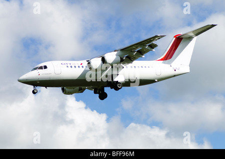 Avro RJ85 operated by Cityjet on approach for landing at Birmingham Airport - Stock Photo