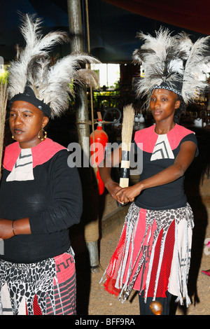 Traditionally dressed a Zulu young adult girl & boy dancing, Moyo Restaurant at Spier , West Cape, South Africa, - Stock Photo