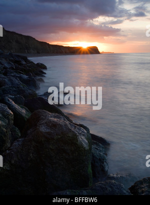 Sunset at Reculver beach in Kent, UK. - Stock Photo