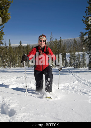 A snow shoer in deep snow near Mount Bachelor in the Oregon Cascade Mountains in winter. - Stock Photo