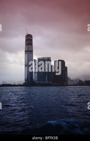 An atmospheric view of International Commerce Centre (ICC) and the West Kowloon waterfront area in Hong Kong. - Stock Photo