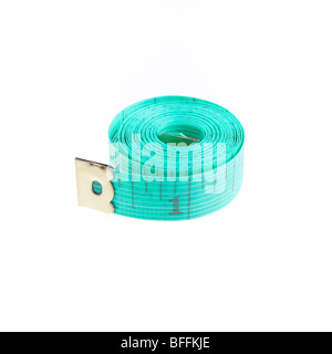 Dressmakers or Tailors rolled up tape measure isolated against white background.