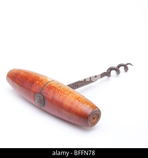 Wooden handled Vintage Corkscrew isolated against white background. - Stock Photo
