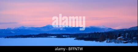 Sunset with pink sky over Teslin Lake, Yukon. - Stock Photo