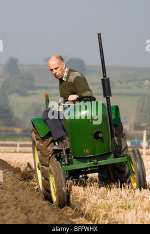A farmer ploughing with a Crawley 75 vintage tractor, Bulcote, Nottinghamshire, England. UK - Stock Photo