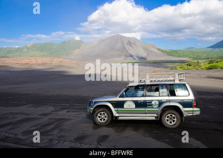 4WD vehicle in front of an active volcano. Click for details. - Stock Photo