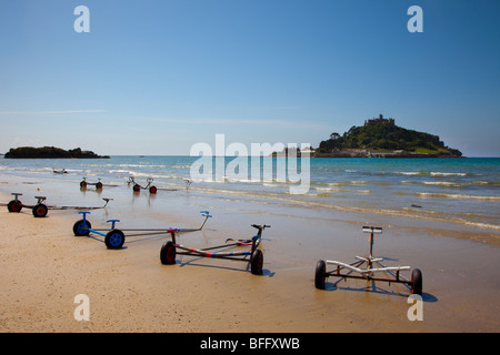 Empty Boat Trailers, secure, safety, weathered, connect, hitch, equipment on the Beach at St Michael's Mount near - Stock Photo