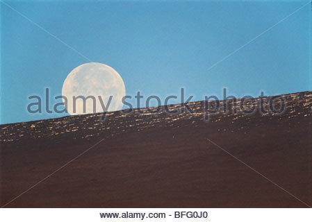Moonset over Mauna Loa, Hawaii Volcanoes National Park, Hawaii - Stock Photo