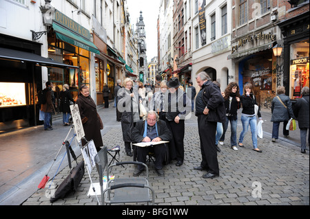 Street artist at work in Brussels in Belgium - Stock Photo