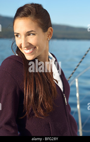 Young woman on sailboat, (portrait) - Stock Photo