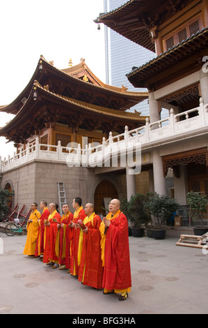 Buddhist monks in front courtyard of Jing'An temple in Shanghai, China. - Stock Photo