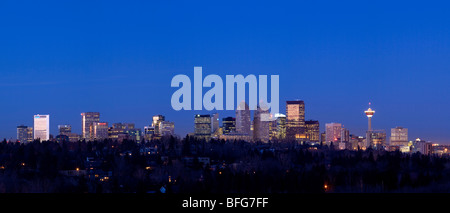 Panoramic view of Calgary Alberta looking north with a view of the Calgary Tower on a clear night - Stock Photo