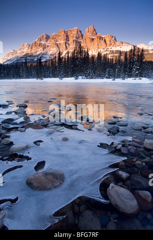 Sunset at Bow River looking to Castle Mountain in the Canadian Rocky Mountains, Banff National Park, Alberta, Canada - Stock Photo