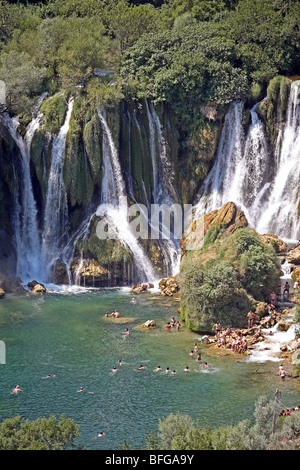 Bosnia and Herzegovina, Herzegovina Ljubuski district. Kravica Waterfalls on the Trebizat River with visiting tourists. - Stock Photo