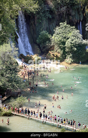 Bosnia and Herzegovina, Ljubuski district. People swarm on Trebizat River for swim and bath refreshment on hot summer - Stock Photo