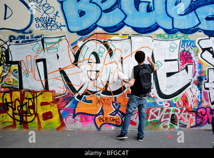 Paris France Street Scene Young Male Teen Graffer Painting Wall With