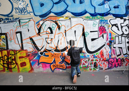 Paris, France, Street Scene, Young Male Teen Street Graffer, Painting Wall with Spray Paint, Graffiti - Stock Photo