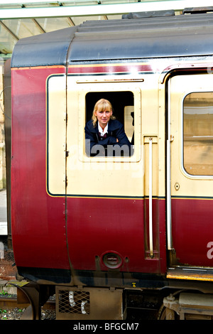 A Female Driver at the window of a Scotrail  (Strathclyde Passenger Transport) liveried class 156 Super Sprinter - Stock Photo