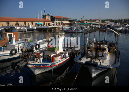 small local greek cypriot fishing boats with expensive pleasure craft in kato paphos harbour republic of cyprus - Stock Photo