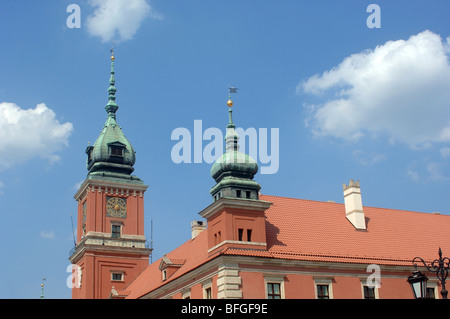Upward view of the Royal Castle in Warsaw, Poland showing the architectural detail and a pleasant blue sky with - Stock Photo