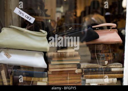 Reproduction vintage handbags in a shop window in Soho London - Stock Photo