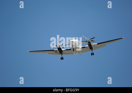 Twin Turboprop landing-  Beech Super King Air 350 Fixed wing multi engine (19 seats / 2 engines) - Stock Photo