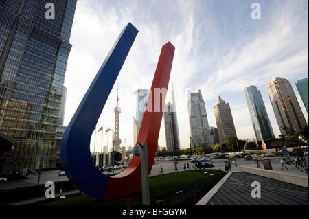 Sculpture with city skyline in Pudong commercial district, Shanghai, China. 14-Oct-2009 - Stock Photo