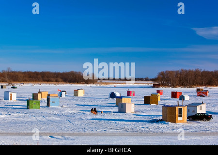 Ice fishing shacks on the Red River, Selkirk, Winnipeg, Manitoba, Canada - Stock Photo