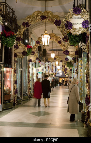 Christmas shopping in the Picadilly Arcade, off Picadilly. - Stock Photo